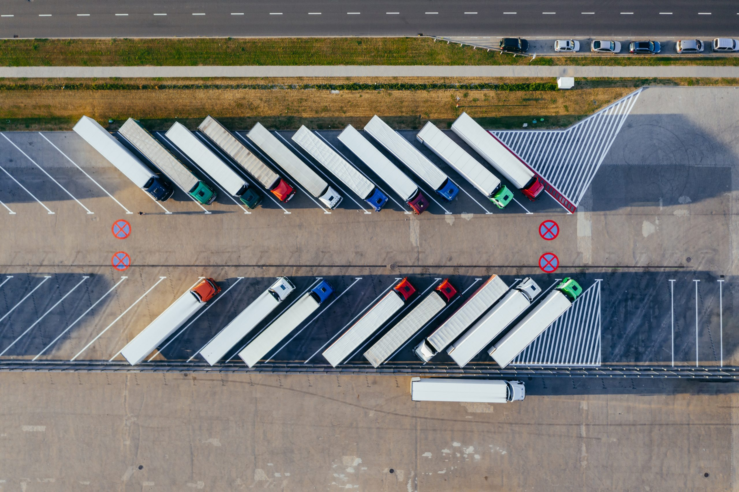 aerial-photography-of-trucks-parked-2800121